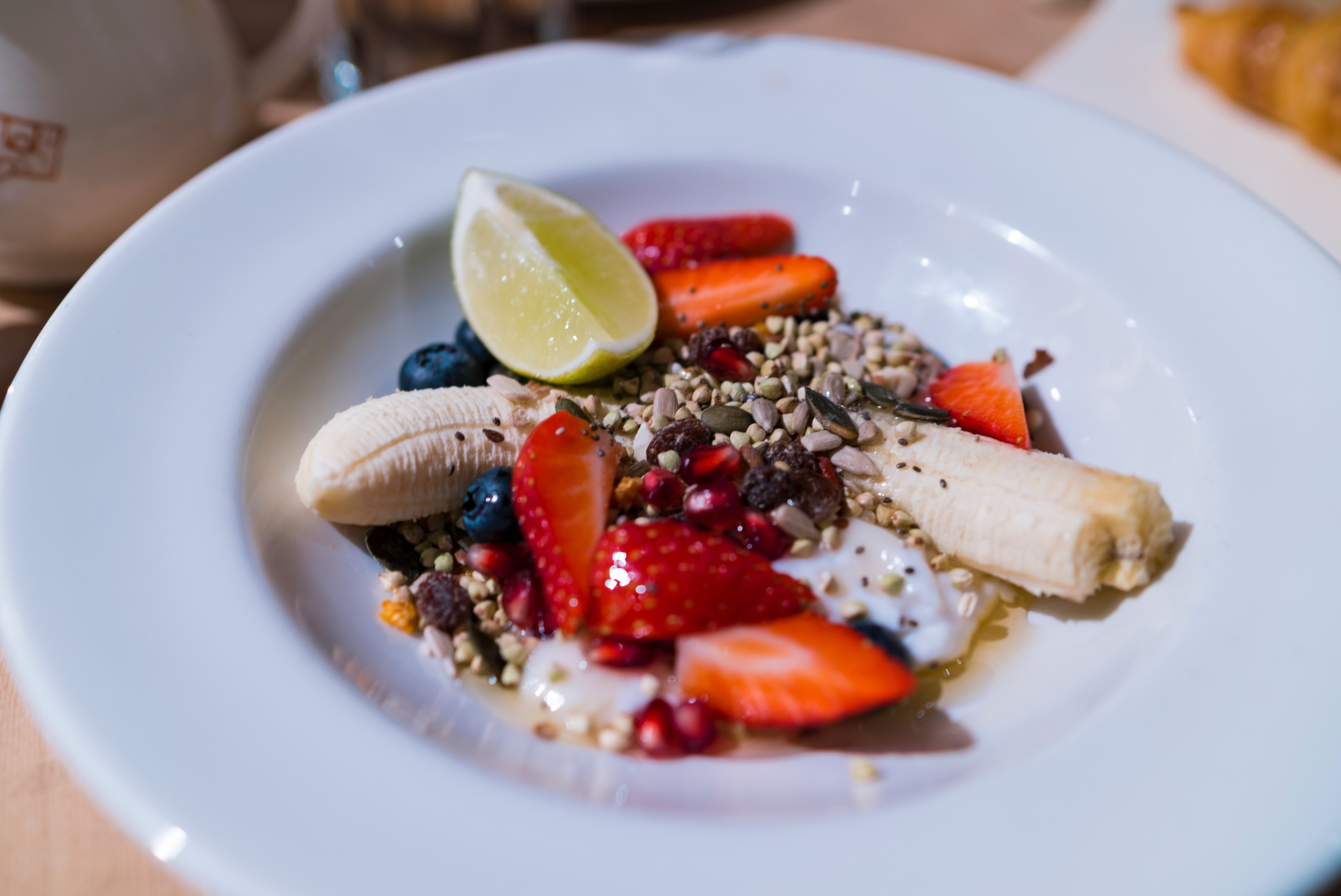 Seeds on fruit with yoghurt and honey
